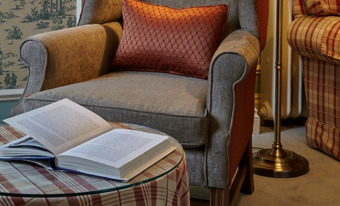 Relax in a comfy armchair in The Reading Room