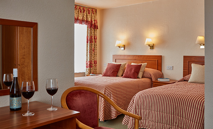 Comfortable standard twin room at The Royal York & Faulkner Hotel, Sidmouth