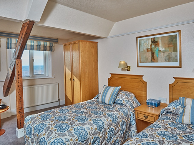 Sea view twin bedroom at The Royal York & Faulkner Hotel, Sidmouth