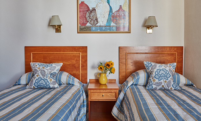 Comfortable twin bedroom at The Royal York & Faulkner Hotel, Sidmouth